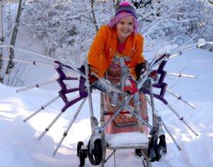 Jenni in fancy vehicle in snow