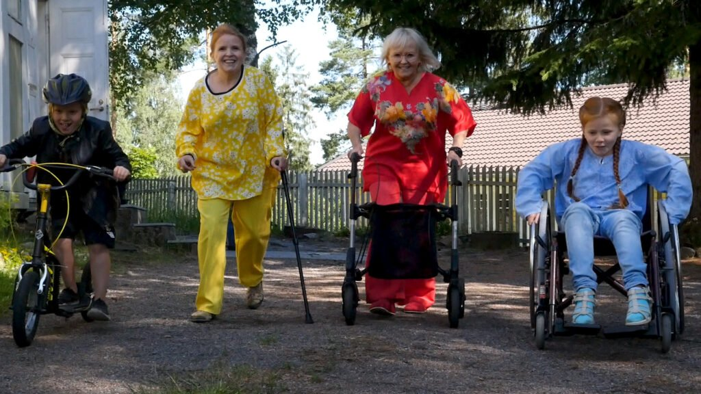 4 People with different walking aids ,each person clothed uni colored