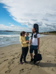 Teller and parents on a beach