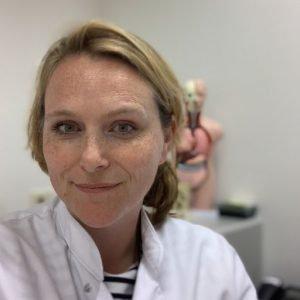 Photo of blonde female medical doctor